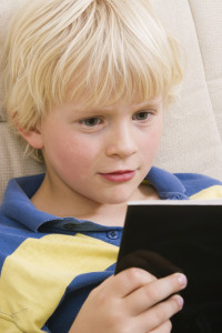 http://www.dreamstime.com/stock-photography-little-boy-reading-book-image2627082