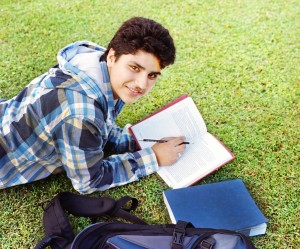 http://www.dreamstime.com/royalty-free-stock-images-college-student-reading-over-grass-image28690289