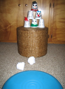 We rolled socks into snowballs and drew snowmen faces and hats on paper cups.