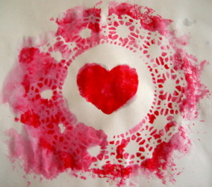 "A second valentine is created in the sponging process. When the paint dries, help your child carefully remove the doily to magically reveal a ""bonus"" valentine!"
