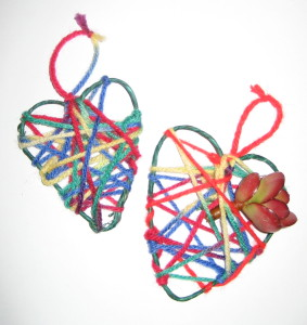 Two hanging hearts made with pipe cleaners and wrapped yarn. I added a flower for whimsy.