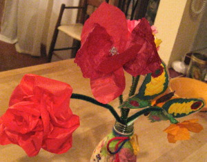 H. chose two colors of red to make the hibiscus (right); we used a silver pipe cleaner to make the stamen.