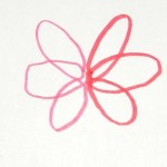 A completed Looping Flower shape with six petals.