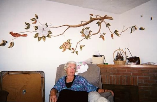 My mother in front of one of the many murals she painted for various family members. This one of a magnolia branch was a gift for her brother and his wife when they were newlyweds.