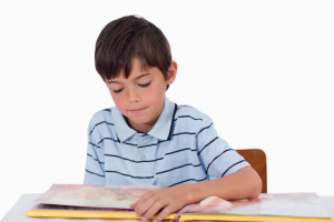 http://www.dreamstime.com/stock-photos-boy-reading-book-image22692063