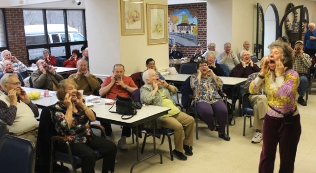"Here, I lead seniors in doing more Brain Gym activities: The Energy Yawn, followed by some Belly Breathing. We then switched on our spirits by singing together, ""Oh What a Beautiful Morning!"""
