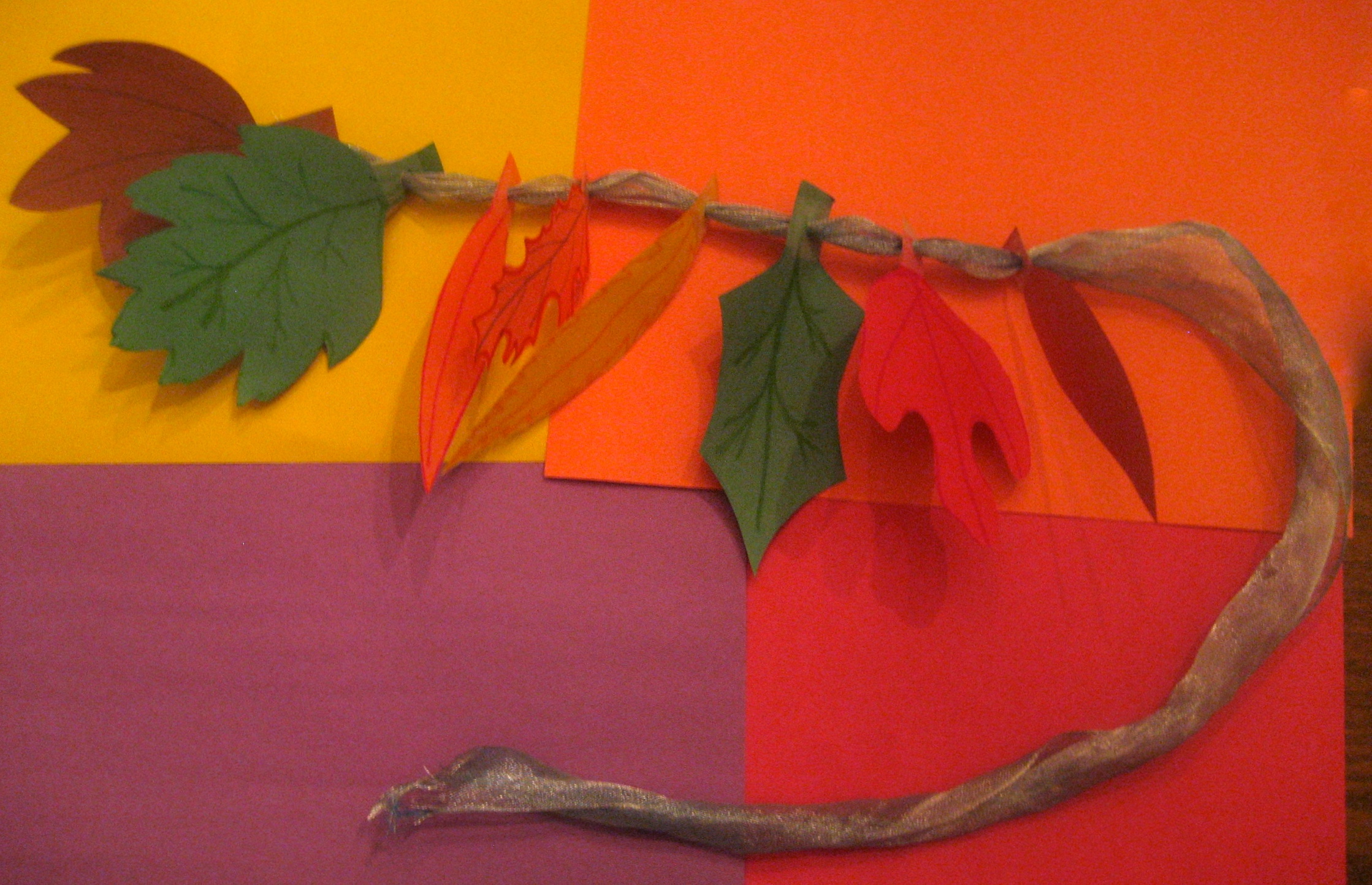 Homemade leaves, strung on a pretty ribbon, make a decorative fall banner and a joyful way to learn about leaves and trees.