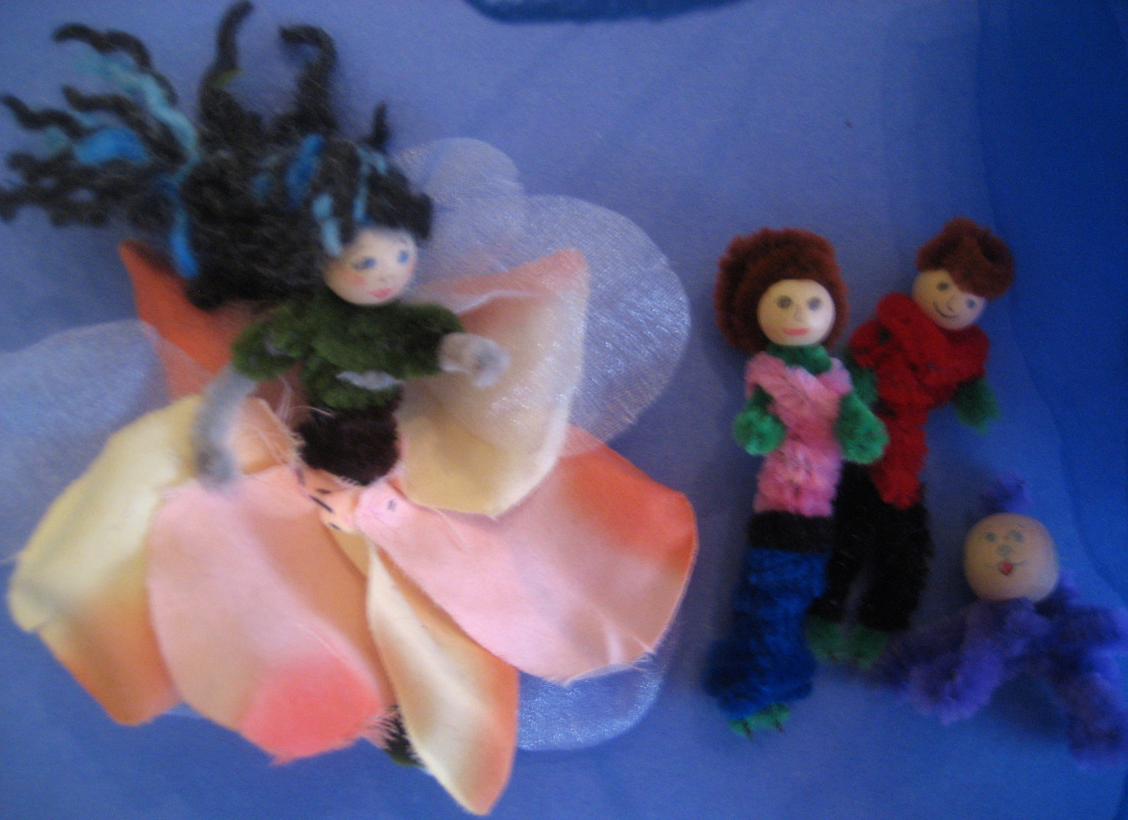 Three flower fairies with their fairy dog (all sans wings at the moment).
