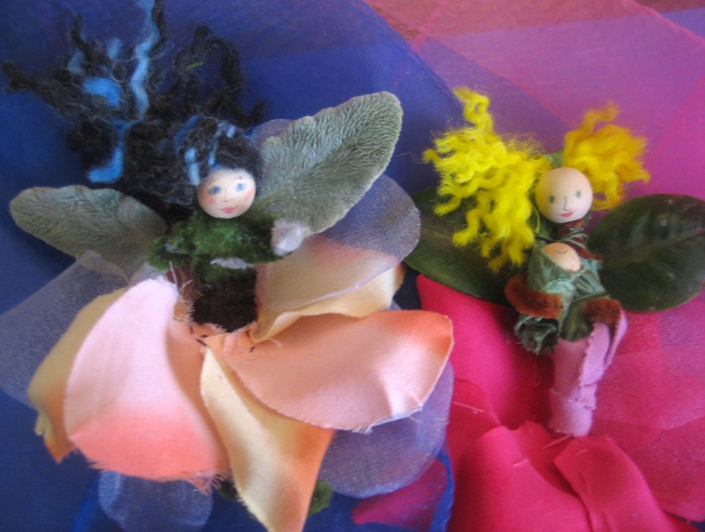 Two rose petal flower fairies (with wings made of lamb's ear and camellia leaves).
